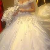 صور تفسير حلم لبس الفستان الابيض
