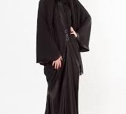 صورة تفسير حلم لبس العبايه