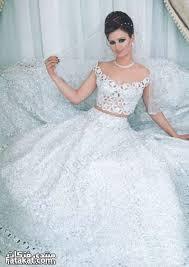 صورة تفسير حلم لبس فستان الزفاف
