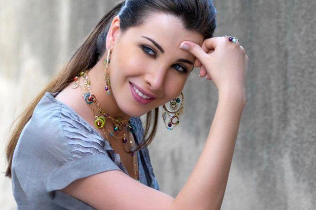 صورة فنانة مشهورة و ليها عدد كبير من المعجبين , معلومات عن نانسي عجرم 13723